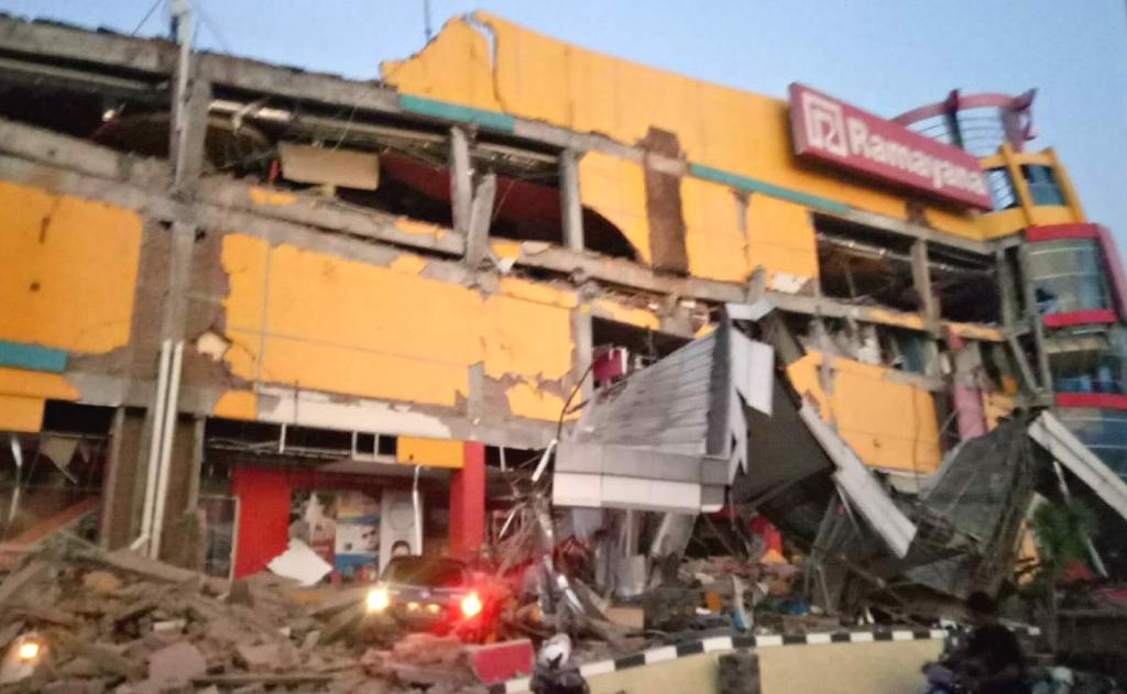 A powerful earthquake hit central Indonesia on Friday, causing a tsunami that slammed into a city on Sulawesi island with officials saying the tremor had levelled 'many' buildings.  The shallow 7.5 magnitude quake sparked terror among locals who fled into the streets and raced to higher ground fearing tsunami waves.  The disaster agency briefly issued a tsunami warning before lifting it.