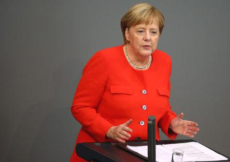 German Chancellor Angela Merkel condemned xenophobic attacks and the use of Nazi slogans in a robust speech to parliament on Wednesday after the most violent far-right demonstrations in decades exposed deep divisions in the country.  In an unusually rowdy session in the Bundestag (lower house) later, far-right Alternative for Germany (AfD) deputies stormed out of the chamber after a Social Democrat (SPD) accused them of being 'unsavory' right-wing radicals.  Protests by right-wing militants in the eastern city of Chemnitz two weeks ago after the fatal stabbing of a German blamed on two migrants have reignited a fierce debate about Merkel's 2015 decision to let in more than a million refugees.