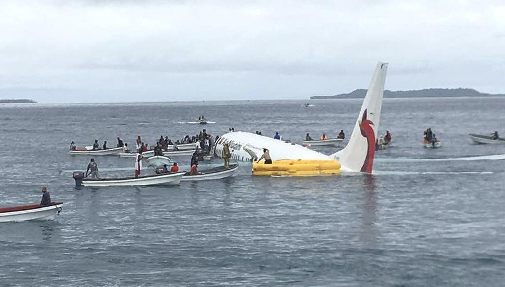 A passenger on a plane that crashed into a Pacific lagoon on Friday said the flight attendants were panicking and he saw water pouring through a hole in the side of the plane before he was able to escape.