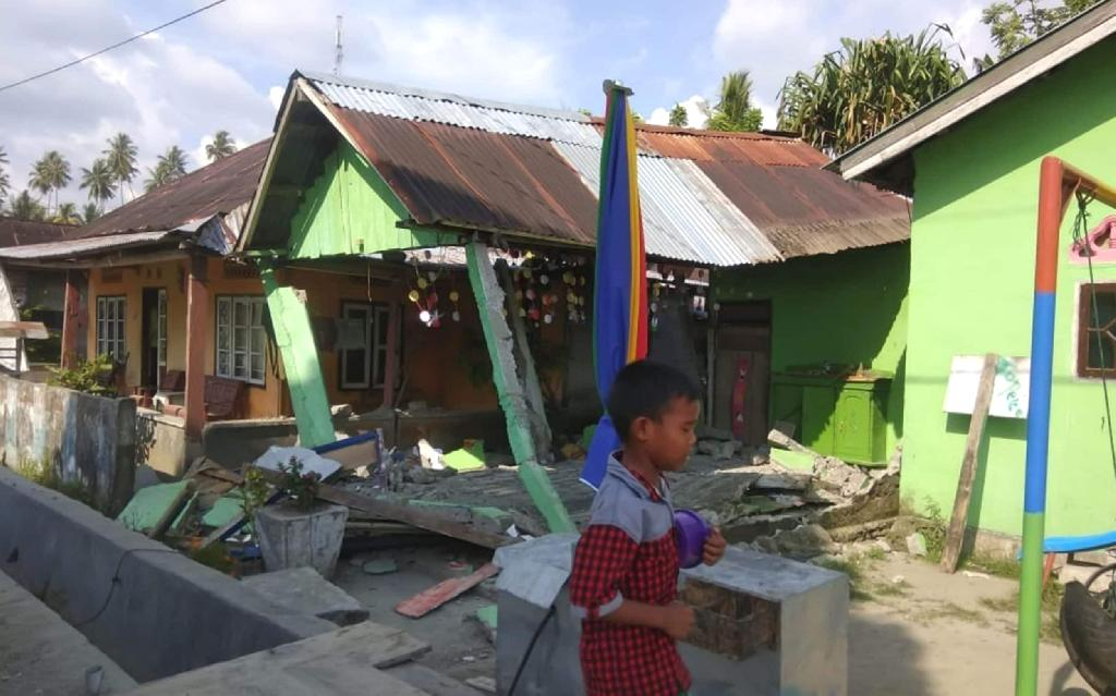 """Indonesia was struck by a powerful 7.5 magnitude earthquake Friday, the US Geological Survey said, but there were no immediate reports of deaths or injuries. The country's national disaster agency briefly issued a tsunami warning before cancelling it. The strong quake hit central Sulawesi island at a shallow depth of some 10 kilometres (six miles), just hours after a smaller quake killed at least one person in the same part of the country. The latest quake was a higher magnitude than those that killed hundreds on the island of Lombok earlier this year. Friday's tremor was centred 78 kilometres north of the city of Palu, the capital of Central Sulawesi province, but was felt some 900 kilometres south in the island's largest city Makassar. Lisa Soba Palloan, a resident of Toraja, around 175 kilometres south of Palu, said locals felt several quakes Friday. Damage from the 7.5 magnitude earthquake in Donggala, central Sulawesi Credit: AFP """"The last one was quite big,"""" she said. """"Everyone was getting out their homes, shouting in fear."""" Indonesia is one of the most disaster-prone nations on earth. The archipelago nation lies on the Pacific """"Ring of Fire"""", where tectonic plates collide and many of the world's volcanic eruptions and earthquakes occur. A series of quakes that struck Lombok this summer killed about 500 people and forced hundreds of thousands into evacuation shelters or tents. In 2004, a tsunami triggered by a magnitude 9.3 undersea earthquake off the coast of Sumatra in western Indonesia killed 220,000 people in countries around the Indian Ocean, including 168,000 Indonesians."""