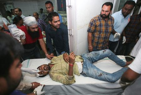 Video footage from the scene showed hundreds had gathered to watch the burning of an effigy as part of the Dussehra festival celebrations, when a commuter train ran through the crowd.  The toll can rise,' State police chief Suresh Arora told Reuters, adding emergency officials were still trying to ascertain the extent of the disaster on the outskirts of Amritsar in Punjab state.  A Reuters witness at the scene saw bodies of victims strewn around rail tracks, friends and relatives stood around in shock, many were sobbing and appeared distraught.