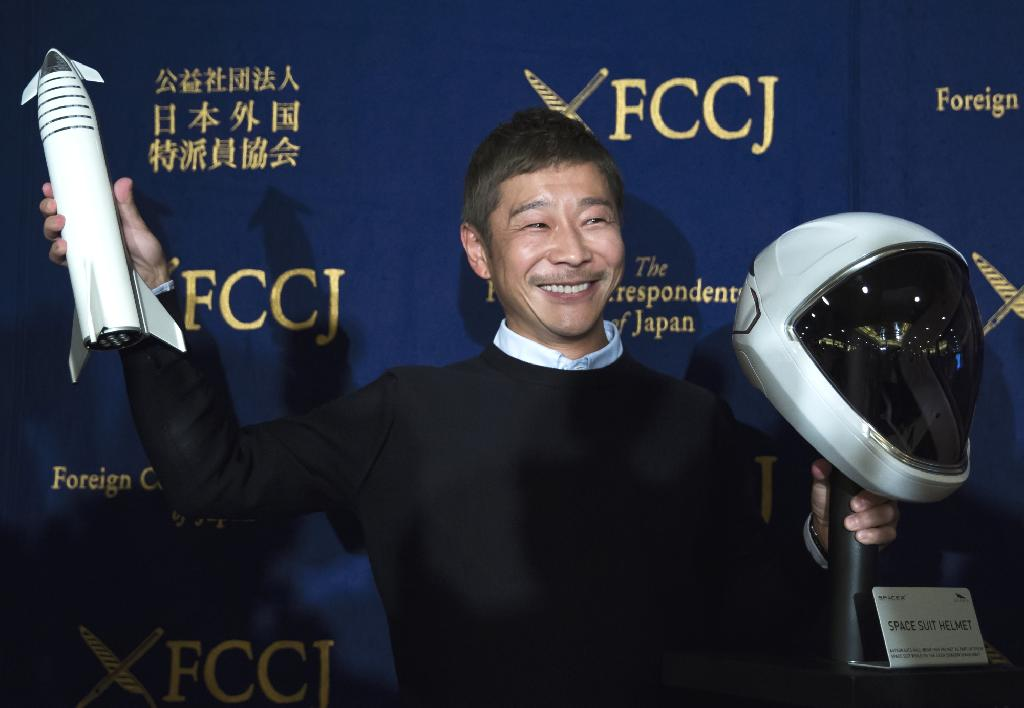 """The founder of Japan's second-largest online shopping site Zozo Inc. was introduced last month as the first passenger on a flight to the moon scheduled for 2023, on a rocket built by Space Explorations Technologies Corp. The announcement instantly raised his global profile, which before was mainly based on his $200 million-plus splurge on artworks.  As a result, they could concentrate more, be more productive, and actually go home after six hours,"""" Maezawa told reporters at the Foreign Correspondents' Club of Japan in Tokyo, where he held a news conference to answer questions about the lunar trip.  Zozo has grown into Japan's go-to site for online fashion shopping, with sales volume reaching 270 billion yen last fiscal year."""