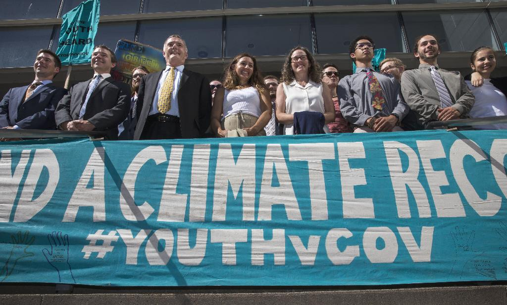 SEATTLE (AP) — Young activists who are suing the U.S. government in a high-profile climate change lawsuit say the case poses important constitutional questions that should fully be evaluated at trial next week.