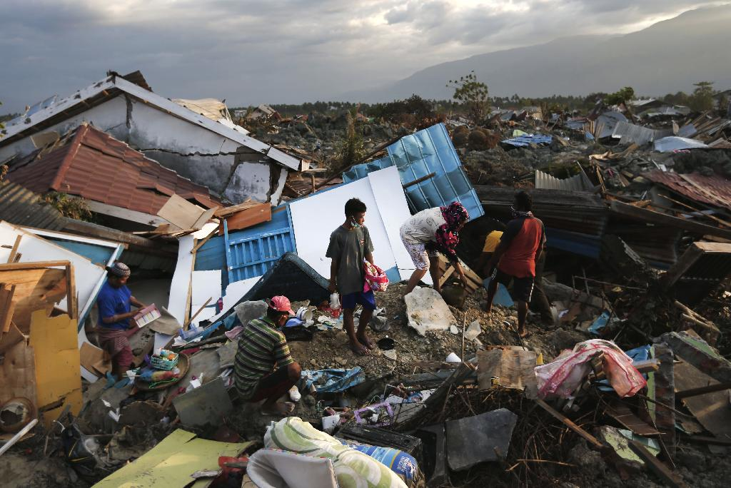 PETOBO, Indonesia (AP) — When the violent shaking from a massive magnitude 7.5 earthquake finally stopped, Selvi Susanti stood up and realized something strange was happening.