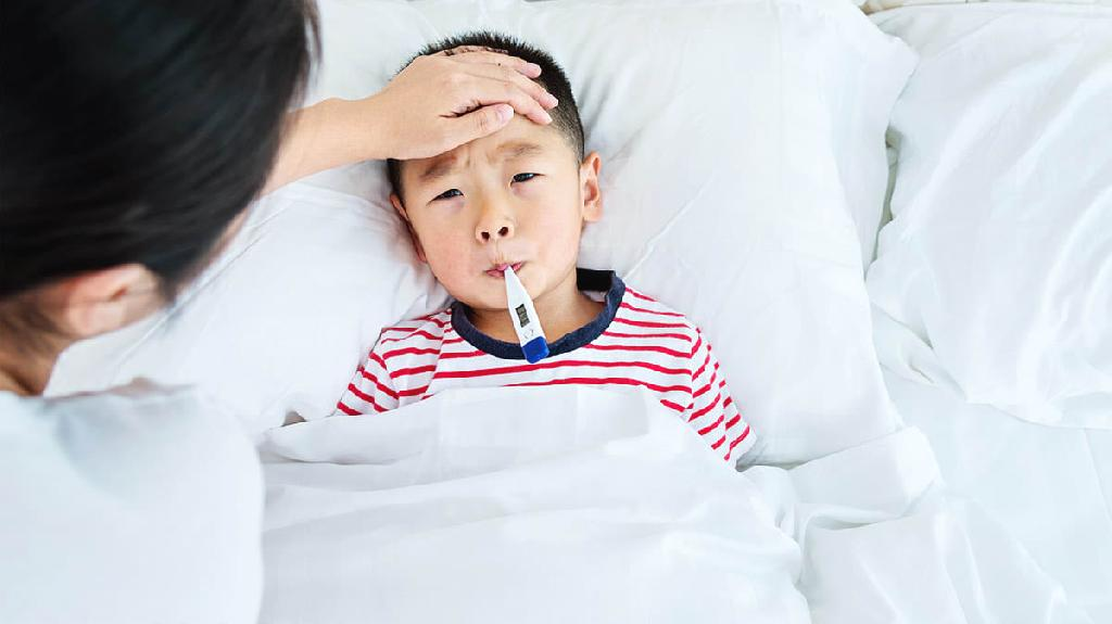 """Your child awakens on a school morning grumbling that """"my tummy hurts,"""" or with a warm forehead and flushed cheeks, or another—probably minor—health complaint. Or he has an odd rash or a few left..."""