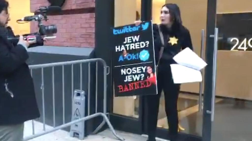 Far-right conspiracy theorist Laura Loomer handcuffed herself to the front