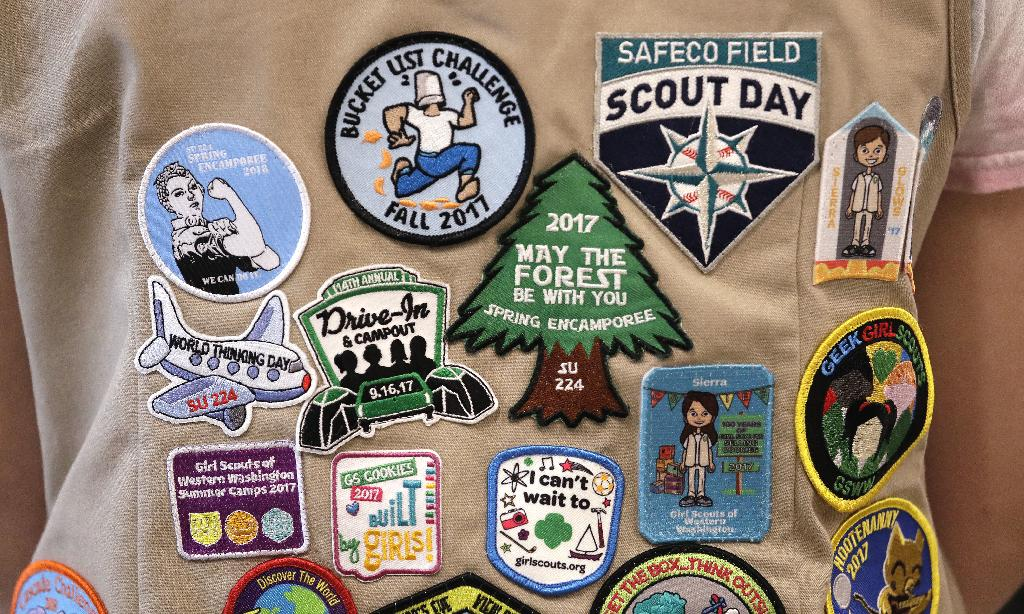 """NEW YORK (AP) — The Girl Scouts of the United States of America filed a trademark infringement lawsuit Tuesday against the Boy Scouts of America for dropping the word """"boy"""" from its flagship program in an effort to attract girls."""