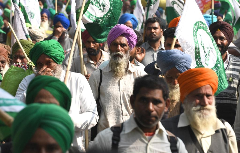 More than 300,000 Indian farmers have killed themselves in the last two decades mainly because of poor irrigation, failed crops and being unable to pay back loans.  Participants marched through central Delhi chanting slogans and holding placards emblazoned with 'Down With Modi Government' and 'Long Live Farmer Unity' as thousands of riot and armed policemen stood guard.  'The farmer crisis has got twice as bad in the last five years,' Sadhu Singh, a farmer from northern Punjab state known as India's rice bowl, told AFP.
