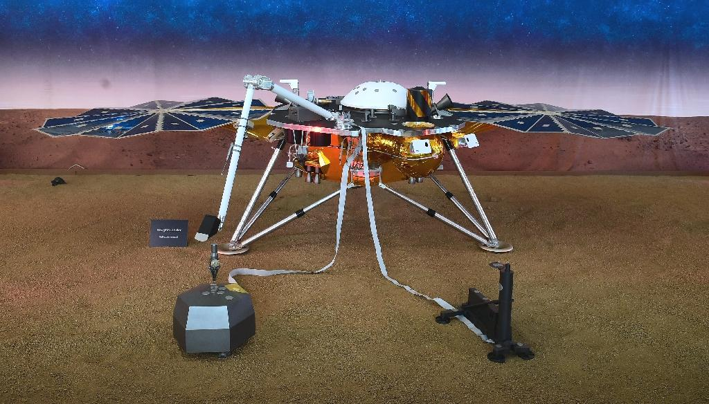 After safely landing on Mars following its nearly seven month journey, NASA has released the first pictures taken by its InSight spacecraft, which has opened it solar arrays to charge batteries.  The $993 million lander, which landed on Monday and appears to be in good shape, will soon begin unfolding its robotic arm and deploying its quake-sensors on the Martian surface.  NASA engineers are planning to begin work with its robotic arm soon, but are proceeding with caution.