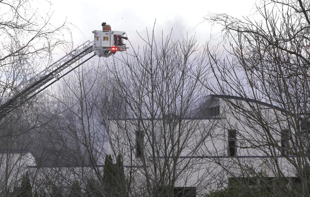COLTS NECK, N.J. (AP) — The Latest on a family found dead as their mansion burned (all times local):