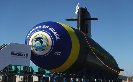 President Michel Temer and his right-wing successor, President-elect Jair Bolsonaro, both pressed the button that lowered into the sea the 1,700-ton submarine named Riachuelo at a Rio de Janeiro naval base.  Temer's wife, Marcela, had christened the vessel, by smashing a champagne bottle against its hull.  The submarines being built by the Brazilian Navy in partnership with France's defense company Naval Group, formerly known as DCNS, are a modified version of the Scorpene class diesel-powered submarine.