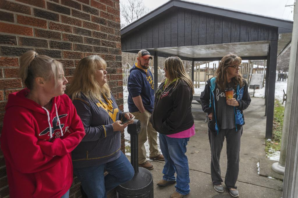 CHARLESTON, W.Va. (AP) — Their faces covered in black soot, three adults safely rescued after several days in an inactive West Virginia coal mine were mobbed by loved ones in a teary reunion, then they thanked the crews that got them out.
