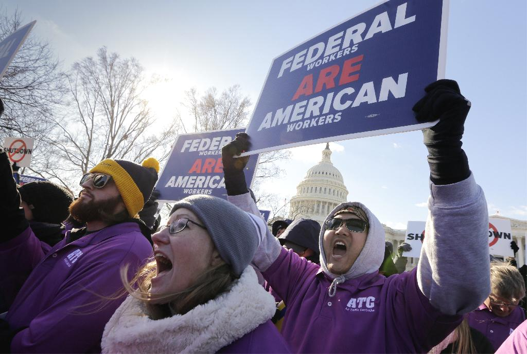 OGDEN, Utah (AP) — Payday will come Friday without any checks for about 800,000 federal employees affected by the government shutdown, forcing workers to scale back spending, cancel trips, apply for unemployment benefits and take out loans to stay afloat.