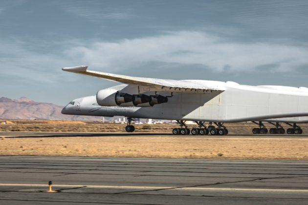 Stratolaunch, the aerospace venture created by Microsoft co-founder Paul Allen, says its twin-fuselage, six-engine aircraft raced as fast as 136 mph down the runway at California's Mojave Air and Space Port today during its latest taxi test. That's almost takeoff speed for the world's largest airplane, which is designed to serve as a flying launch platform for orbital-class rockets. One of the pictures released in the wake of today's test run shows the plane's nose gear rising from the runway, and Stratolaunch used the hashtag #wheelie in its celebratory tweet. It's been said that one of the challenges during these… Read More