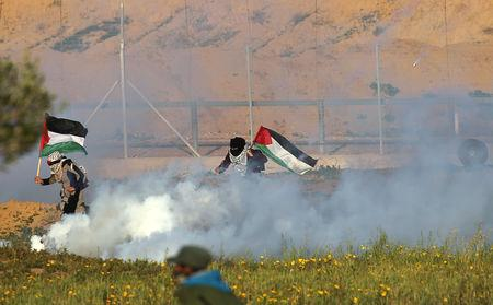 Israeli troops shot dead two Palestinian teenagers including a 14-year-old boy during Gaza border protests on Friday, Palestinian health officials said.  Israel's military said it had opened fire in response to explosives and rocks hurled at the border fence.  Palestinians have been staging weekly protests since last March at the border of Gaza, an enclave controlled by the Islamist militant group Hamas.