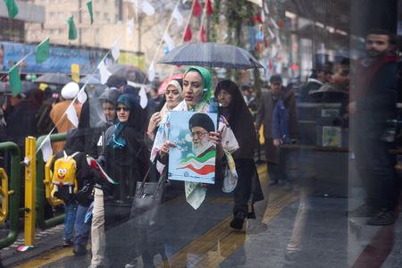 On Feb 11, 1979, Iran's army declared its neutrality, paving the way for the fall of Shah Mohammad Reza Pahlavi, the United States' closest ally in the Middle East.  State TV showed crowds defying cold rainy weather and carrying Iranian flags while shouting 'Death to Israel, Death to America,' trademark chants of the revolution which ousted the United States' most important ally in the Middle East.  'Much to the dismay of America, the revolution has reached its 40th year,' read one banner.