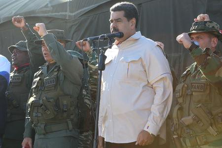 MOSCOW/LONDON (Reuters) - Venezuela's Nicolas Maduro has sought OPEC support against U.S. sanctions imposed on his country's oil industry, citing their impact on oil prices and potential risks for other members of the producer group.  OPEC says it is concerned with oil policy, not politics.  More than 40 nations including the United States, European powers and most of Latin America have recognized Maduro's rival, Juan Guaido, as the country's rightful head of state, following disputed elections last year.