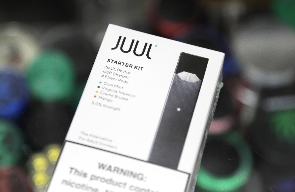 WASHINGTON (AP) — The head of the Food and Drug Administration is questioning whether electronic cigarette maker Juul and its new partner Altria are following through on pledges to help reverse the boom in underage vaping.