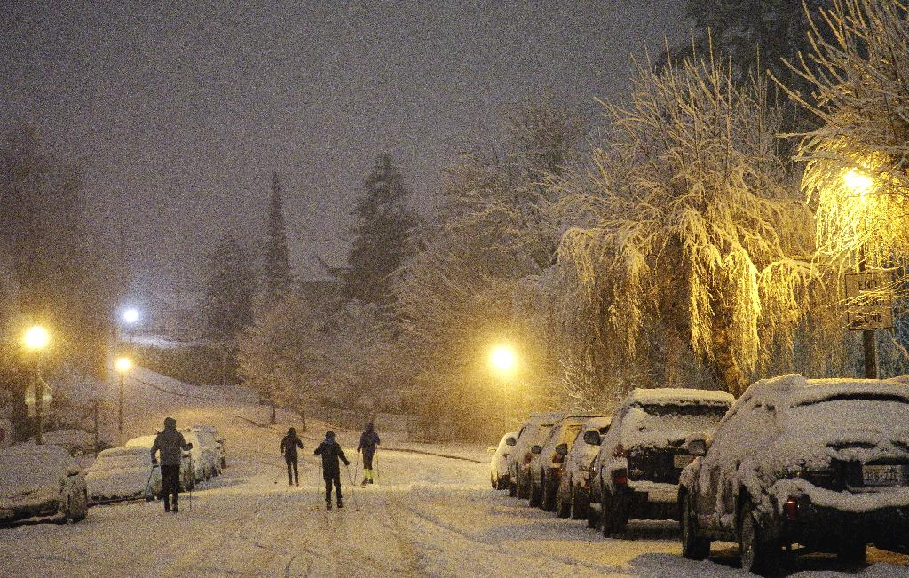 SEATTLE (AP) — Residents of the Pacific Northwest took to neighborhood hills with skis, sleds or even just laundry baskets Saturday to celebrate an unusual dump of snow in a region more accustomed to winter rain.