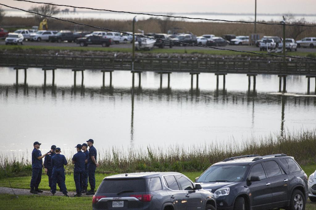 DALLAS (AP) — Texas authorities have found part of a human body at the site where a Boeing 767 cargo plane crashed Saturday, although it's unclear whether it belongs to the missing crew member.