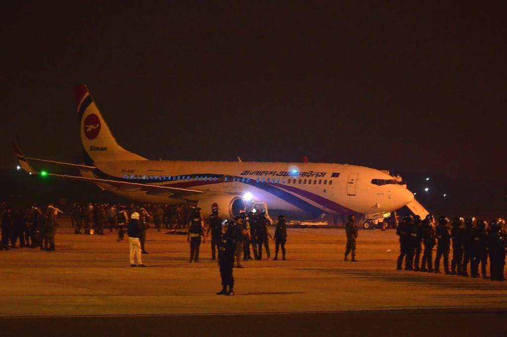 A would-be hijacker shot and killed by Bangladesh commandos was carrying a fake gun and told negotiators he wanted to commandeer a Dubai-bound flight because he had troubles with his wife, officials said Monday.  The 25-year-old was shot and later died of his wounds after taking a crew member hostage on the Biman Airlines jet, forcing it to make an emergency landing at Chittagong airport late Sunday.  Airport manager Wing Commander Sarwar-e-Jaman said the hijacker was 'psychologically imbalanced'.