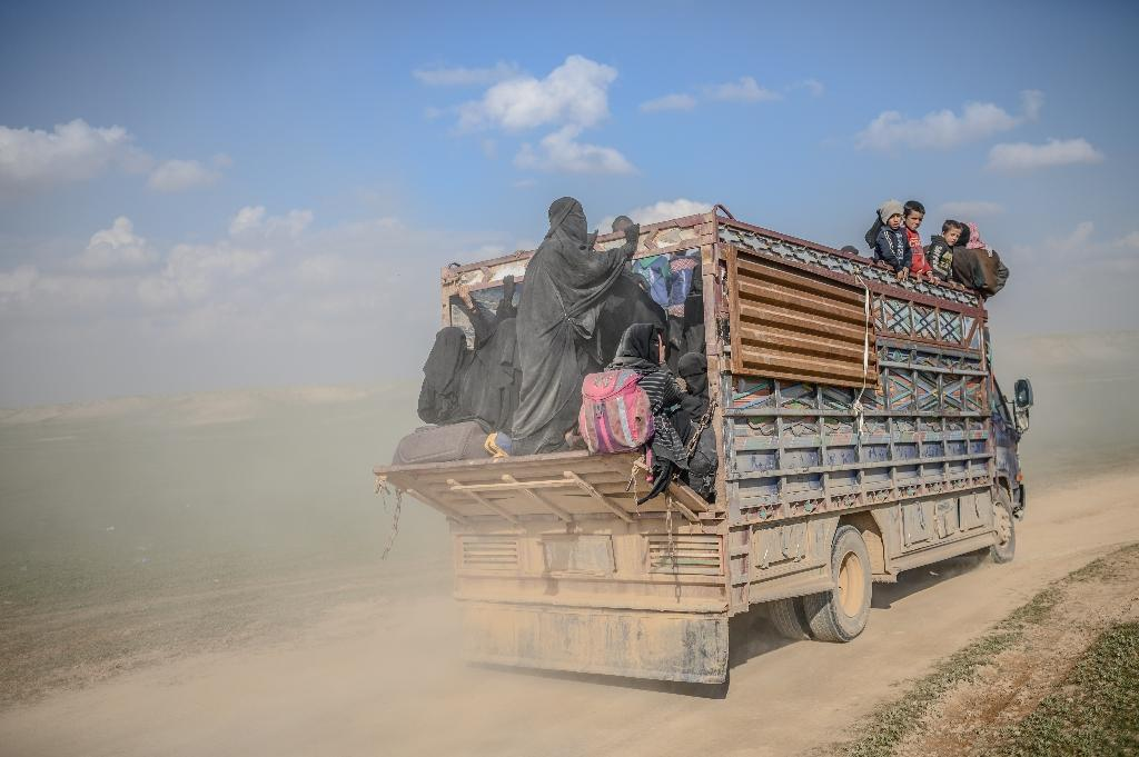 US-backed forces evacuated over 40 truckloads of people from the Islamic State group's last Syria redoubt on Monday, as they sought to clear out civilians before a final push to crush the jihadists.  The Syrian Democratic Forces (SDF) have slowed down their offensive on the final pocket due to the presence of civilians, with just a scrap of the IS 'caliphate' remaining from a territory that once spanned Syria and Iraq.  An AFP correspondent saw more than 46 trucks crammed with men, women and children, approaching an SDF outpost, 20 kilometres (12 miles) north of the jihadist redoubt.