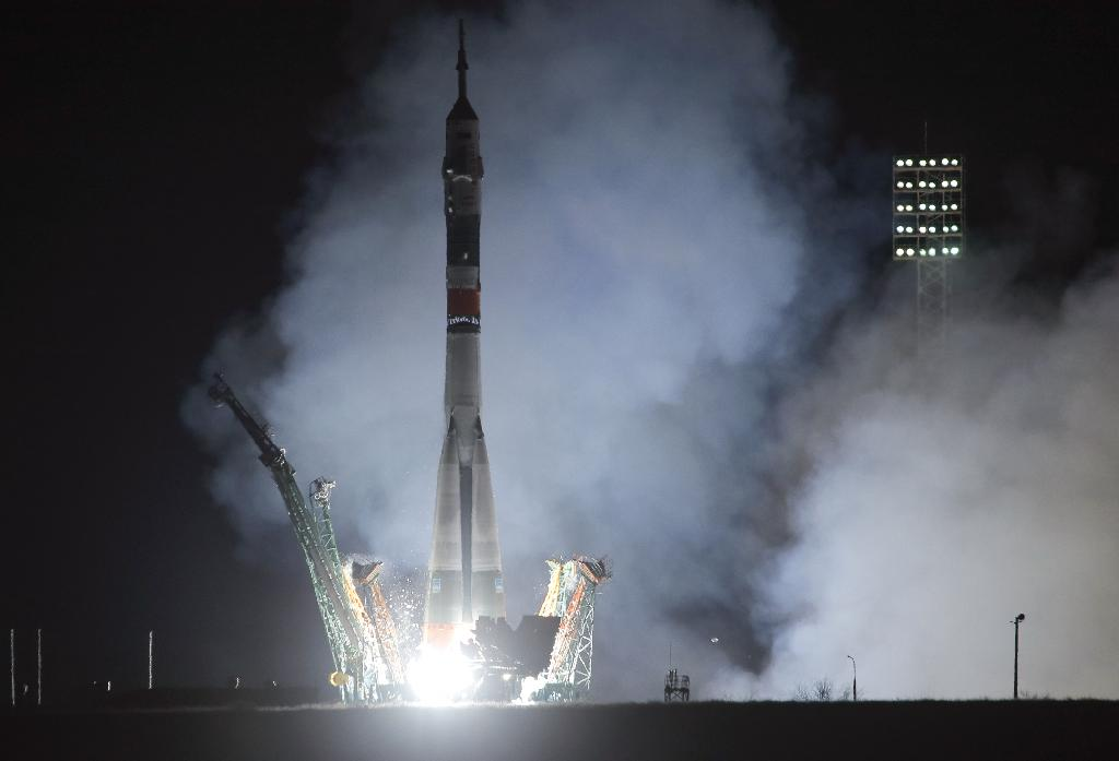 BAIKONUR, Kazakhstan (AP) — A Russian-American crew arrived at the International Space Station on Friday, five months after a botched launch led to an emergency landing for two of the three astronauts.