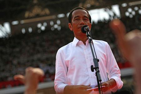 By Ed Davies JAKARTA (Reuters) - When Indonesian President Joko Widodo was elected five years ago, the former furniture salesman seemed to offer a clean break from the military and political elite that had clung to power since the fall of strongman ruler Suharto in 1998. Now, Widodo, 57, is running on his own record for a second term in Wednesday's election, with a comfortable lead in most opinion polls over his rival, former general Prabowo Subianto. (GRAPHIC: Indonesia election by the numbers - https://tmsnrt. ...