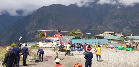 The plane, operated by Summit Air, was not carrying passengers as it was trying to leave what is considered to be one of the world's most dangerous airports due to the shortness of its runway and its location surrounded by mountains.  'Two people died on the spot and the third one died while undergoing treatment in a hospital in Kathmandu,' airport official Pratap Babu Tiwari told Reuters.  The dead included two security guards who were near the helicopter.