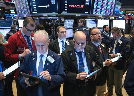 World stocks reversed earlier gains on Monday as underwhelming quarterly results from U.S. banks weighed on Wall Street, while oil prices fell as Russia mulled boosting production.  The U.S. benchmark S&P 500 stock index dipped after Goldman Sachs Group and Citigroup Inc both reported quarterly revenue below consensus estimates, though the index pared losses in afternoon trading.  MSCI's gauge of global equities, which has risen more than 14% this year, dipped 0.03% on Wall Street's negative turn.