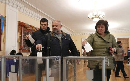 At stake is the leadership of a country on the frontline of the West's standoff with Russia following the 2014 Maidan street protests and the annexation of Crimea.  Surveys make Volodymyr Zelenskiy, who plays a fictitious president in a TV series, the overwhelming favorite to defeat incumbent Petro Poroshenko, whose popularity has been dragged down by patchy efforts to tackle corruption and sliding living standards.  Both men - who traded insults and accusations in a rowdy debate in a soccer stadium in Kiev on Friday - have pledged to keep Ukraine on a pro-Western course.