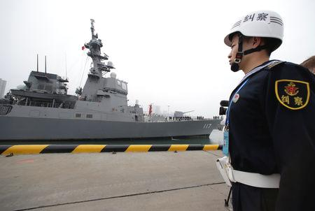 China on Tuesday will mark 70 years since the founding of the People's Liberation Army Navy, where it will show off new warships including nuclear submarines and destroyers at a major review in the waters off Qingdao.  China says warships from about a dozen nations are also taking part - one diplomatic source with direct knowledge said it was 13 countries in total - and the PLA is putting its best foot forward to welcome them.  India, which has been at odds with China over their disputed land border and Beijing's support for India's regional rival Pakistan, has sent stealth guided-missile destroyer the 'INS Kolkata' to take part, along with a supply ship.