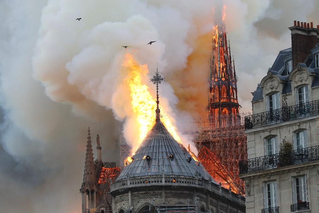 A massive fire was raging Monday at thefamed Notre Dame cathedral in Paris, one of the world's most popular tourist destinations.