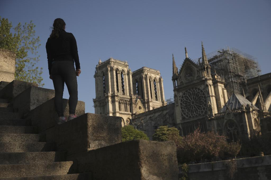 PARIS (AP) — Tourists, devout Catholics and others looked on mournfully at Notre Dame Cathedral Saturday, regretting that they couldn't get inside the magnificent monument on this Easter weekend because of the damage caused by a violent fire.