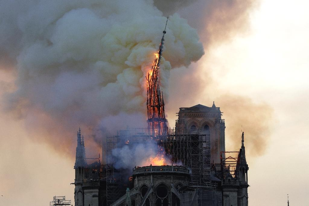 A colossal fire swept through the famed Notre-Dame Cathedral in central Paris on Monday, causing a spire to collapse and raising fears over the future of the nearly millenium old building and its precious artworks.  The fire, which began in the early evening, sent flames and huge clouds of grey smoke billowing into the Paris sky as stunned Parisians and tourists watched on in sheer horror.  The cause of the blaze was not immediately confirmed but the cathedral had been undergoing intense restoration work to help the 850-year-old gothic masterpiece better deal with the tests of time.