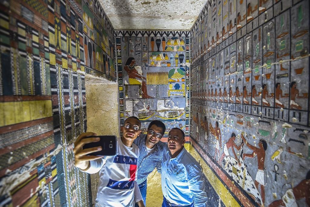 In a major archaeological discovery, Egypt on Saturday unveiled the tomb of a Fifth Dynasty official adorned with colourful reliefs and well preserved inscriptions.  The tomb, near Saqqara, a vast necropolis south of Cairo, belongs to a senior official named Khuwy who is believed to have been a nobleman during the Fifth Dynasty, which ruled over Egypt about 4300 years ago.  'The L-shaped Khuwy tomb starts with a small corridor heading downwards into an antechamber and from there a larger chamber with painted reliefs depicting the tomb owner seated at an offerings table,' said Mohamed Megahed, the excavation team's head, in an antiquities ministry statement.
