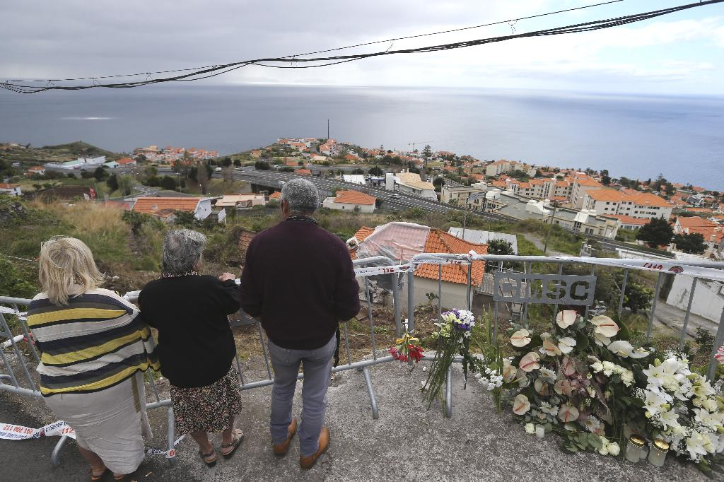 FUNCHAL, Portugal (AP) — Relatives of some of the 29 German tourists who died in a bus crash in Madeira arrived on the Portuguese island on Friday as investigators pushed on with the task of finding out why the bus veered off the road and plunged down a slope.