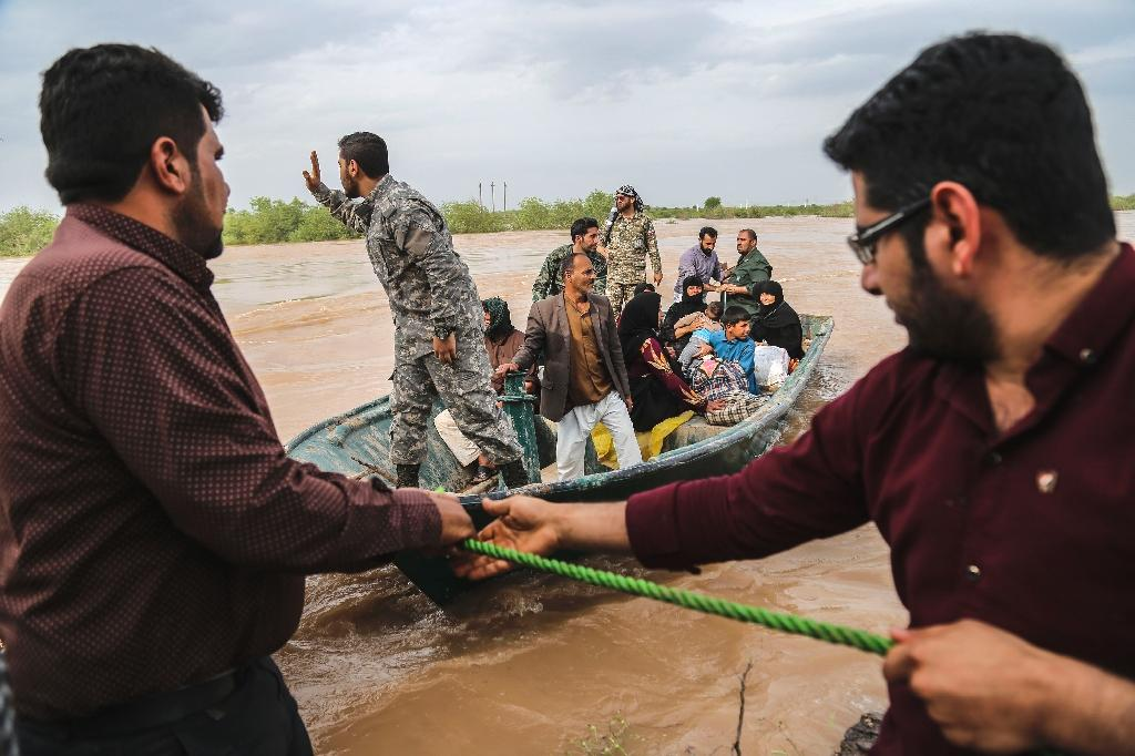 Floods in Iran have killed 76 people and caused more than $2.2 billion in damages in recent weeks, officials said Sunday, with warnings still in place for large swathes of the country.  'With the death of five people in the Khuzestan province flood and another person in Ilam province the death toll has now reached 76' since March 19, according to a statement published online by the coroner's office.  The two southwestern provinces are the latest overwhelmed by floods that first hit the northeast of the usually arid country, forcing hundreds of thousands to evacuate from cities and villages.