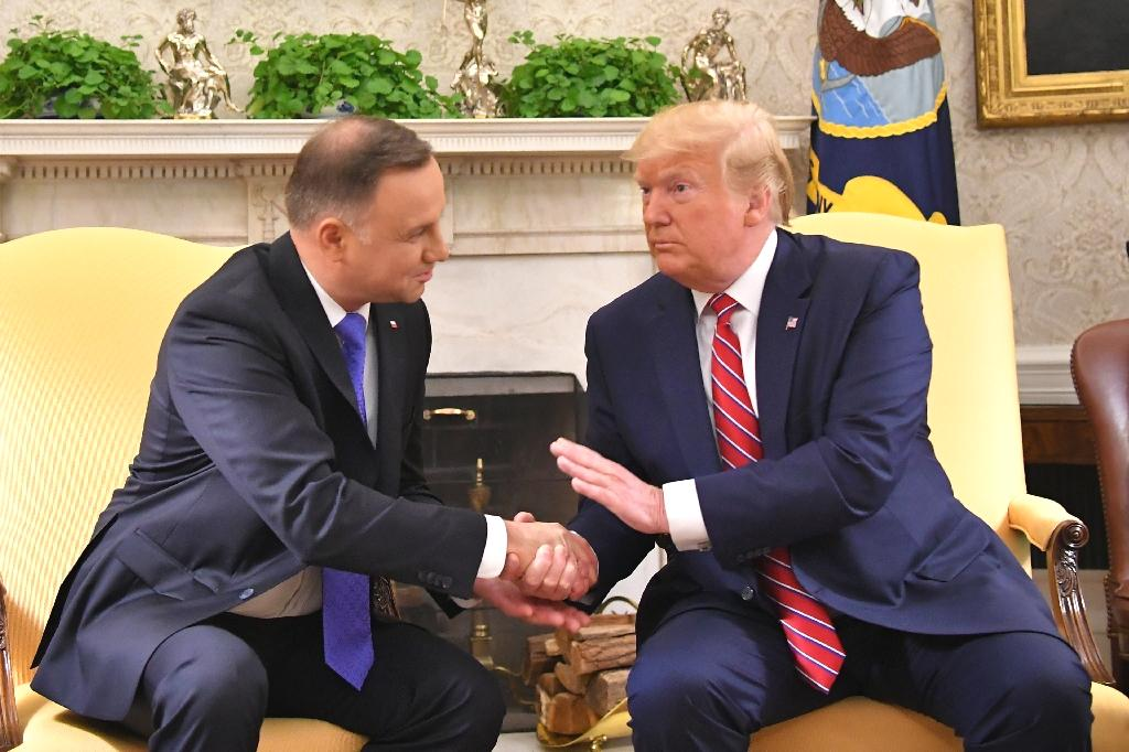 The United States is considering sending 2,000 more troops to Poland, President Donald Trump announced Wednesday at White House talks with his Polish counterpart Andrzej Duda -- while stopping short of promising a permanent presence.  Trump said the additional US troops would be moved to Poland from fellow NATO-member Germany, but cautioned that the discussions had not been finalized.  Around 5,000 US troops currently rotate in and out of Poland.