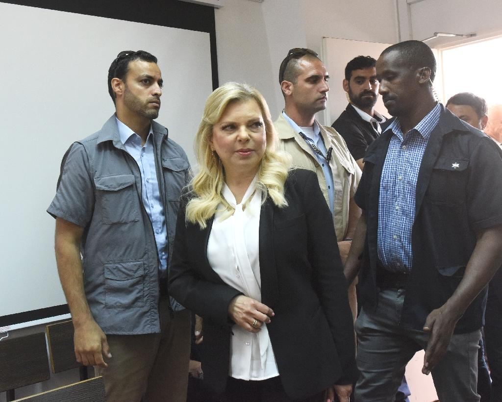 The wife of Israeli Prime Minister Benjamin Netanyahu asked a Jerusalem court Sunday to approve a plea bargain convicting her of fraudulently using state funds for meals, an AFP reporter said.  Under the charges in an amended indictment, Sara Netanyahu would plead guilty to exploiting the mistake of another person and pay a fine along with compensation, but graft charges against her would be dropped.  In a small room at the Jerusalem magistrates' court, packed with journalists, Netanyahu told the judge she was aware of the charges.