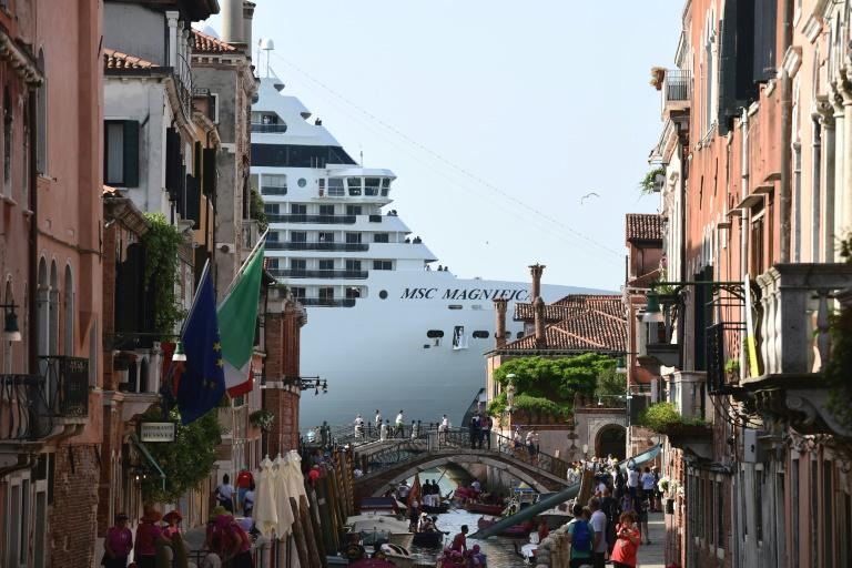 A cruise ship narrowly missed a yacht while being towed out of Venice late Sunday, just a month after a collision there renewed the controversy over the giant vessels.  The 12-deck Costa Deliziosa, which is nearly 300 metres (1,000 feet)  long and carries more than 3,800 passengers and crew, was being towed out in stormy conditions when the near-miss happened.  A video posted by a Venetian writer and artist, Roberto Ferrucci, on his website www.robertoferrucci.com showed the massive cruise ship passing very close to a moored yacht.