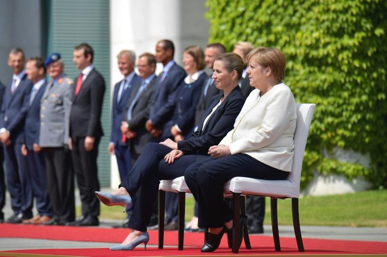 Angela Merkel remained seated during national anthems at an official ceremony on Thursday, as the German chancellor apparently sought to prevent a repeat of uncontrollable shaking with a rare change of protocol.  After greeting Denmark's new Prime Minister Mette Frederiksen at the portico of the chancellery, a smiling Merkel walked her over to a podium where both leaders took their seats.  The unusual move came a day after a similar ceremony when the German chancellor was seen shaking involuntarily for the third time.