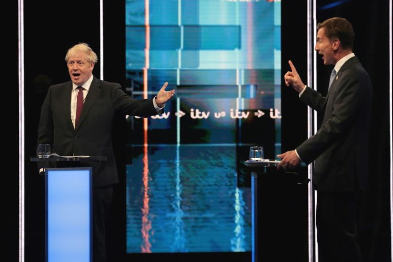 Boris Johnson stood accused Tuesday of having nothing to offer Britain but 'blind optimism' as he and his rival for the premiership clashed over Brexit in a bad-tempered TV debate.  Johnson is the runaway frontrunner to replace Theresa May later this month, wooing voters with a promise to take Britain out of the European Union on October 31 whatever happens.  'If we want to make a success of Brexit it's not about blind optimism, it's about understanding the details that will get us the deal that's right for country,' said Hunt, the current foreign minister.