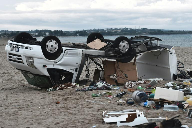 Six people died and at least 23 were injured as a fierce storm tore through a beachfront in one of Greece's top tourist areas, terrifying thousands of holidaymakers caught in the open, authorities said Thursday.  Six tourists including two children were killed -- two each from the Czech Republic, Russia and Romania -- in the northern region of Halkidiki, near Greece's second city Thessaloniki, in the storms late Wednesday.  'There was panic, people were howling and running to hide inside,' said Haris Lazaridis, owner of a tavern where a 54-year-old woman from Romania and her son were killed when the roof caved in.