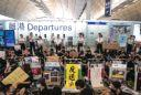 "(Bloomberg) -- Protests forced Hong Kong's airport to suspend check-ins for departing flights -- its second straight day of major service disruptions -- as embattled local leader Carrie Lam warned that the city risked sliding into an ""abyss.""Hundreds of black-shirted protesters staged a sit-in at the departures hall at Hong Kong International Airport, preventing some checked-in passengers from reaching their planes. Airlines including Cathay Pacific Airways Ltd. had already canceled hundreds more flights Tuesday, the day after the government decided to briefly shut the airport during a mass demonstration in the arrivals area.The interruptions follow a weekend of violence that saw police fire tear gas into a subway station and shoot rubber bullets at close range.Here's the latest:Remaining Check-Ins Canceled (6:52 p.m.)Hong Kong's airport halted check-ins for remaining departures for a second straight day, the airport authority said in a statement, after protesters blocked outgoing gates in a dramatic sit-in. The cancellation of all check-ins was announced after hundreds of black-shirted protesters sat down in the airport's departure halls. The move came a day after authorities shut the airport amid a mass rally in the arrival hall Monday.China's Leader Faces a Dilemma (6:14 p.m.)It's the question worrying some in Hong Kong: Will Chinese President Xi Jinping send in troops to restore order? Xi now faces a dilemma over whether to wait the protesters out or bring in his forces. The likelihood he'll do that remains low. While Xi could choose to do away with the city's autonomy, there would be immense cost to both the Chinese leader and his country. It could dwarf any fallout from the weekslong protest movement. Among those risk factors is his protracted trade war with the U.S.Mainland Airports Stand To Benefit (5:52 p.m.)The disruptions at Hong Kong's airport could be a boon for its competitors. It drove big gains Tuesday in shares of airports just over the Chinese border. Shenzhen Airport Co. soared by the 10% daily limit, while Guangzhou Baiyun International Airport Co. was up 4.5% to a record high. They had also rallied Monday. The unrest may lead global carriers to reevaluate Hong Kong's role as an international hub and flights allocated there, helping megacity Shenzhen establish itself as a hub in the longer run, Citic Securities Co. said.Cathay Parent Backs Government (5:35 p.m.)Cathay Pacific's parent company, Swire Pacific Ltd., said it has ""consistently and resolutely"" supported Hong Kong's development and remains fully committed to the city.UN Agency Urges Restraint (5:29 p.m.)The United Nations High Commissioner for Human Rights condemned police for firing tear gas directly at protesters, saying they created ""a considerable risk of death or serious injury."" It also urged protesters to express their views peacefully. The office ""reviewed credible evidence of law enforcement officials employing less-lethal weapons in ways that are prohibited by international norms and standards,"" spokesman Rupert Colville said in a statement.Departure Gates Closed (4:23 p.m.)The airport closed its north and south departure gates at international Terminal 1, leaving long lines of passengers who had already checked in to wait for further instruction.The closures came as Hong Kong police said at a daily briefing that officers fired 58 rounds of tear gas and seven rounds of rubber bullets as violence escalated Saturday, moves that helped fuel protester anger.Protests Spread to Departures Hall (3:32 p.m.)Hundreds of black-shirted protesters spread to the airport's departures area, bringing passenger check-ins to a crawl. They sat on the floor and blocked the route to the terminal's north departure gates as they chanted ""Shame on Hong Kong police."" A trickle of passengers were still getting through, but others remained in a long line, some sitting warily with their luggage carts. The crew channel was closed off. As the crowd of protesters shifted, the arrivals hall largely emptied out.""They shoot press, they shoot first aid, they are HK police,"" one protester's sign read.Patten: China Intervention Would Be 'Catastrophe' (2:20 p.m.)Hong Kong's last colonial governor, Chris Patten, told the BBC on Tuesday that the government's refusal to formally withdraw the extradition bill and set up an independent inquiry into the protests was to blame for pushing Hong Kong to the abyss. He urged President Xi Jinping and the local government to seek reconciliation avoid forcibly suppressing protests. ""That would be a catastrophe,"" said Patten, who served as governor from 1992 to 1997.Plans for Sunday March Detailed (1:19 p.m.)The Civil Human Rights Front, the group that organized three historically large marches against the extradition bill in June and July, detailed plans to hold a similar public procession at 3 p.m. Sunday. The group's challenge will be maintaining the largely peaceful atmosphere of the earlier events as some protests turn to violence and the police employ more forceful measures to disperse them. It's unclear whether CHRF will get sign-off from the police, who have been withholding approval from some marches.Opposition lawmaker Claudia Mo, a prominent participant in CHRF protests, separately called Lam's contention that she didn't have authority over the police force ""irresponsible."" ""It's very clear right now who is running Hong Kong, and that's Beijing,"" Mo said.Airport Train Services Cut (12:51 p.m.)Hong Kong's Airport Authority announced that trains between downtown and the terminals would depart less frequently after 1 p.m. in a bid to control crowds. The agency said fewer trains were necessary due to reduced flights at the airport. Trains would run at 15-minute intervals instead of the usual 10-minute span, an agency spokesman said.Travelers Confront Protesters at Airport (11:15 a.m.)Some travelers whose flights were disrupted by the airport protests confronted demonstrators, including one man speaking the Mandarin Chinese dialect preferred on the mainland, who complained that his trip had been delayed by a day. One protester apologized to the man, explaining that the government wouldn't listen to their demands. Others shrugged off the delays.Lam: Police Used 'Lowest Level' Force (10:14 a.m.)Lam said police used the ""lowest level of force"" when asked why they had fired tear gas in residential areas, as she held a regular Q+A session ahead of a meeting of the city's Executive Council. She urged calm, a refrain in recent weeks as violence between protesters and police worsens and tear gas is regularly deployed in crowded areas across the city.At one point, she was interrupted by reporters as she sidestepped questions on whether she would resign -- a key protester demand -- and whether she had concrete proposals to ease residents' fears.""It would take a very long time to restore Hong Kong,"" she said, choking up. ""I again call on everyone to set aside prejudice, and be calm to look at the city, our home -- do we really want to push it into the abyss?""Read more on the potential toll of the unrest on Hong Kong's economyLam Says Hong Kong in Chaos (9:48 a.m.)After her session began, Lam asked the public whether they wanted to see Hong Kong fall into an abyss and said the city was in a chaotic situation.The city's rule of law is being hurt, she said, and non-cooperation events affected the airport and traffic. Lam also said she saw further suffering for the city's economy, and that dialogue between the two sides could resume after violence stops.Protesters Call for Return to Airport (9 a.m.)Some protesters called for a return to the airport at 1 p.m. Tuesday, circulating a flyer online calling for people to gather featuring an airplane and blue sky.Hong Kong Airlines vowed its support for the city's government and police and condemned protester violence in a half-page advertisement in pro-Beijing local newspaper Wen Wei Po. It came as state-run Air China Ltd. canceled dozens of scheduled flights to the city on Tuesday, citing issues at the airport in a post to its official account on Chinese social media platform Weibo.Read more from Monday's scene at Hong Kong's airportAirport Resumes Normal Operation (6:40 a.m.)The airport was operating normally as of now, a staff at the airport's customer service hotline said by phone. It is re-scheduling 90 canceled flights from Monday. It may cancel more flights Tuesday depending on the situation as some protesters remained at the arrival hall. Meanwhile, Cathay Pacific has canceled more than 200 flights to and out of Hong Kong Tuesday.(A previous version of this story was corrected after the Airport Authority revised its statement to show flights still departing, check-in closed.)\--With assistance from Iain Marlow, Sebastian Chau, Annabelle Droulers and Stephen Engle.To contact the reporters on this story: Yvonne Man in Hong Kong at yman9@bloomberg.net;Fion Li in Hong Kong at fli59@bloomberg.net;Annie Lee in Hong Kong at olee42@bloomberg.netTo contact the editors responsible for this story: Brendan Scott at bscott66@bloomberg.net, Karen LeighFor more articles like this, please visit us at bloomberg.com©2019 Bloomberg L.P."