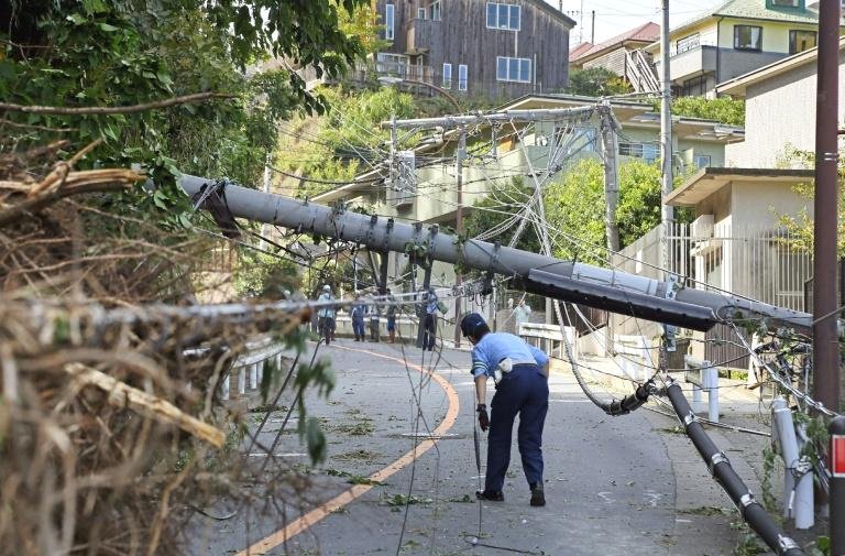 A powerful typhoon that battered Tokyo overnight with record winds killed two people, police said Monday, as cancelled trains caused commuter chaos and more than 100 flights were scrapped, leaving thousands stranded at the airport.  Typhoon Faxai, packing winds of up to 207 kilometres (129 miles) per hour, made landfall in Chiba just east of the capital before dawn, after barrelling through Tokyo Bay.  The transport disruptions unleashed by the storm came less than two weeks before the start of the Rugby World Cup, and delayed the arrival of the Australian team -- a reminder that Japan's typhoon season could present challenges for organisers.
