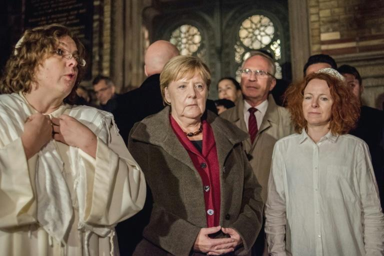 Chancellor Angela Merkel joined people gathered at Berlin's main synagogue late Wednesday for a silent vigil, showing solidarity with the victims of a deadly gun attack in Halle and saying 'no to antisemitism'.  Offering words of encouragement for New Synagogue rabbi Gesa Ederberg on a Yom Kippur holiday tainted by violence, Merkel said: 'Unfortunately, on your holy day today, we've witnessed something horrible.