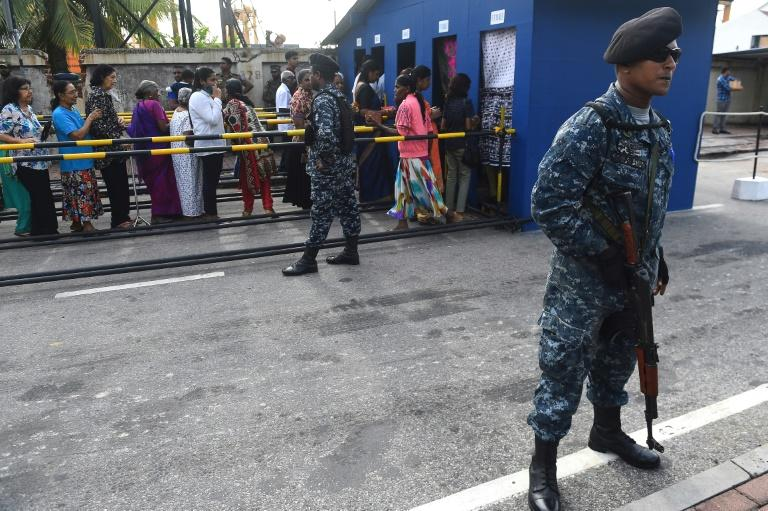 Sri Lanka's police Tuesday suspended two senior officers for falsely warning of a suicide attack similar to the Easter Sunday bombings that killed at least 258 people in April.  Several luxury hotels received a message from police last week cautioning them to step up security.  Police spokesman Ruwan Gunasekera said the two officers responsible were being disciplined for causing panic.