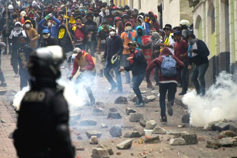 Protesters in Ecuador fought a running battle with security forces Wednesday in a second day of violent protests over a fuel price hike that forced the government to suspend most of the country's deliveries of crude.  The violence broke out as thousands of people representing indigenous groups, farmers, students and labor unions marched on a square in Quito's historic center near the government headquarters.  Masked demonstrators threw Molotov cocktails and paving stones.