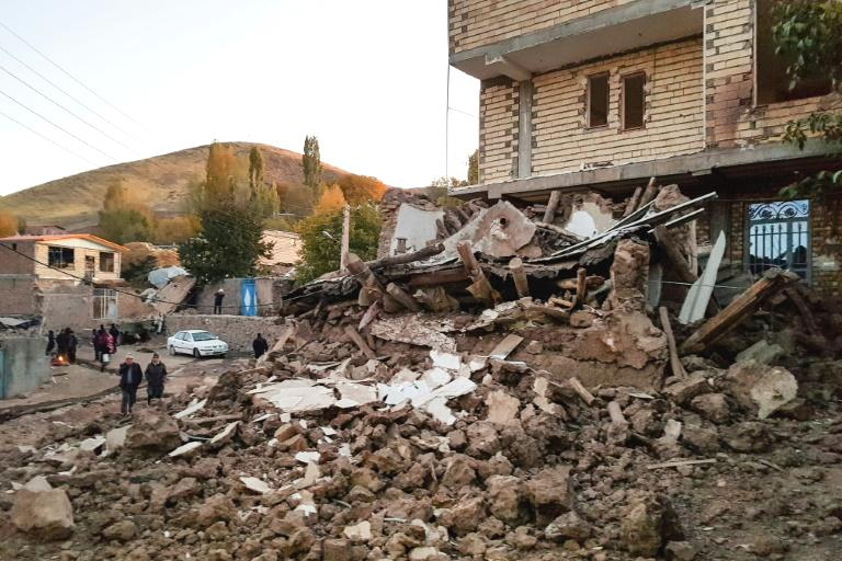 An earthquake rocked northwestern Iran before dawn on Friday, killing at least five people and injuring more than 300 in crumbling and collapsed buildings.  The 5.9-magnitude quake struck at 1:17 am (2247 GMT Thursday) about 120 kilometres (75 miles) southeast of the city of Tabriz, in East Azerbaijan province, the Iranian Seismological Centre said.  Described as 'moderate', the quake was eight kilometres (five miles) deep and was followed by five aftershocks.